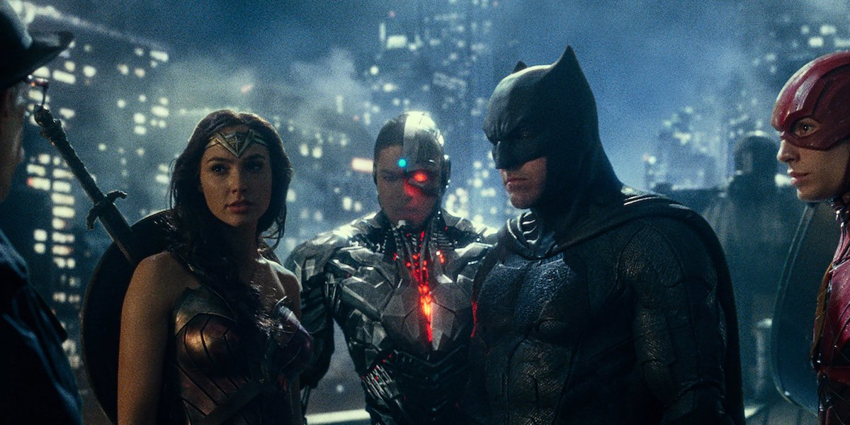 Wonder Woman, Cyborg, Batman and the Flash stand on a rooftop in 'Justice League'