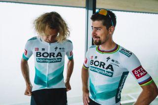Daniel Oss and Peter Sagan show off the new Bora-Hansgrohe kit for the Tour de France