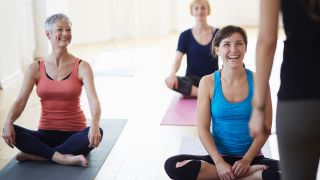 What is hot yoga? Image shows group yoga class