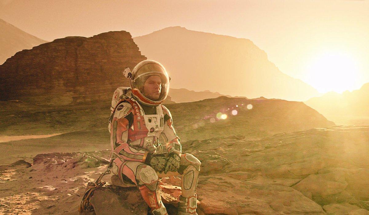 The Martian Matt Damon sitting on a martian rock