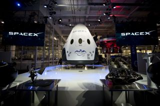 SpaceX's manned Dragon Version 2 can carry as many as seven astronauts into orbit. Image released May 29, 2014.