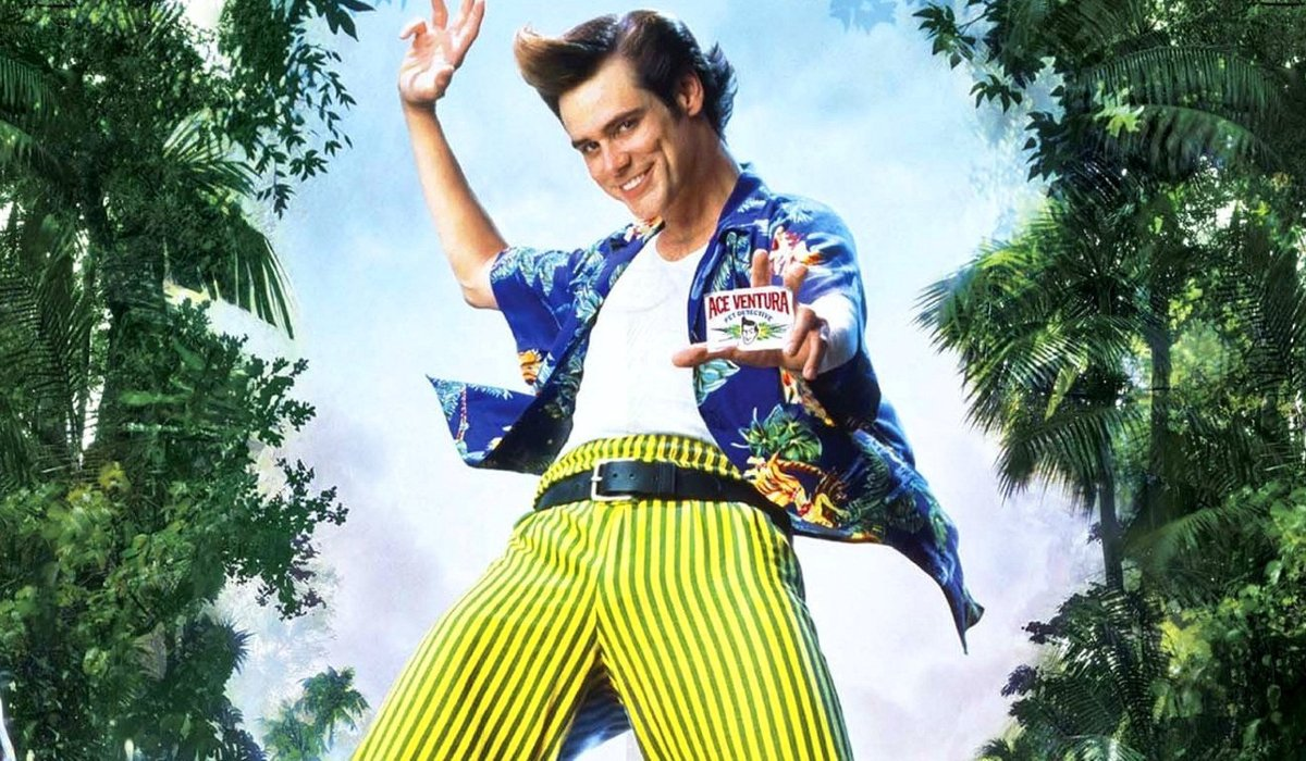 Ace Ventura: When Nature Calls Jim Carrey flashes his ID card among the trees