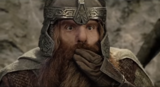 Gimli the Dwarf, covering his mouth in surprise.