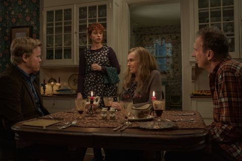 Jake's family sits around the dinner table as his girlfriend moves to leave.