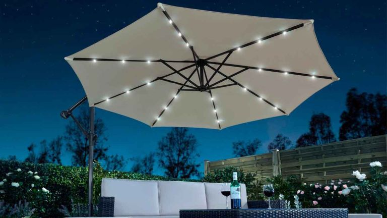 Solar LED Cantilever Parasol with Optional Cover in garden over sofa set