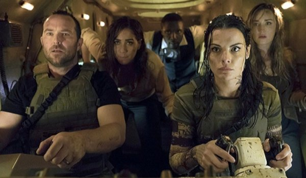 Blindspot Jaimie Alexander and her team in an armored vehicle