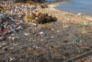 An aerial view of damage to Sukuiso, Japan, a week after the earthquake and subsequent tsunami devastated the area in March, 2011. Also this isn't likely to happen on the East Coast, it's not inconceivable.