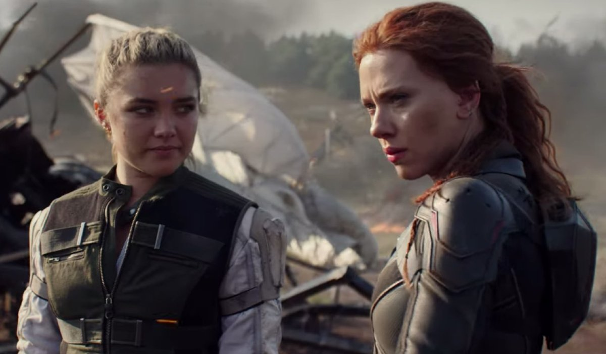 Black Widow Florence Pugh and Scarlett Johansson stand near some wreckage