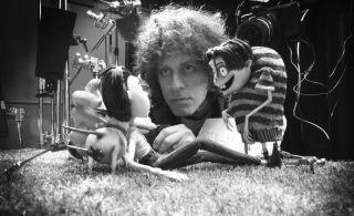Man adjusting stop motion puppets