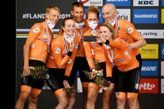 Ellen Van Dijk, Annemiek van Vleuten, Riejanne Markus, Koen Bouwman, Bauke Mollema, and Jos van Emden celebrate silver in the mixed relay
