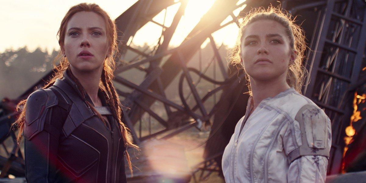 Natasha Romanoff/Black Widow (Scarlett Johansson) and Yelena Belova (Florence Pugh) look on in Black Widow (2021)