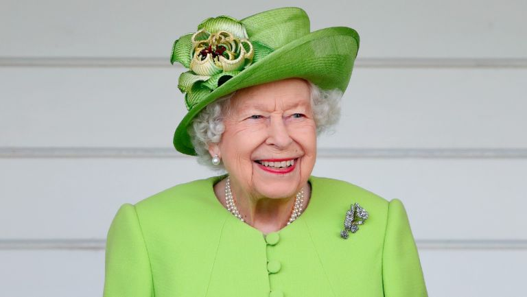 The Queen (wearing her Vanguard Rose Brooch which she received in 1944 from Messrs John Brown and Co. when she launched HMS Vanguard) attends the Out-Sourcing Inc. Royal Windsor Cup polo match and a carriage driving display by the British Driving Society at Guards Polo Club, Smith's Lawn on July 11, 2021 in Egham, England.