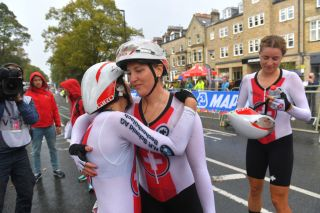 Kathrin Stirnemann (centre) celebrates sixth place at the team time trial mixed relay with Swiss teammates Elise Chabbey and Marlen Reusser at the 2019 UCI Road World Championships in Yorkshire