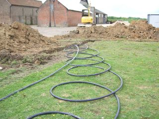 a ground source heat pump during installation