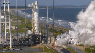 An Orbital ATK Antares rocket first stage fires its RD-181 main engines during a static-fire test May 31 at Wallops Island, Virginia.