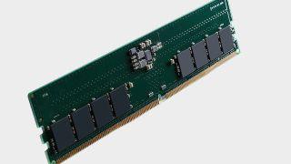 Kingston DDR5 memory module on a gray background.