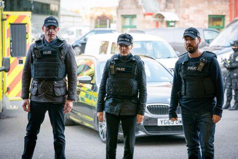 Chris Lomax, Jo Davidson and Steve Arnott at a OCG raid in Line of Duty