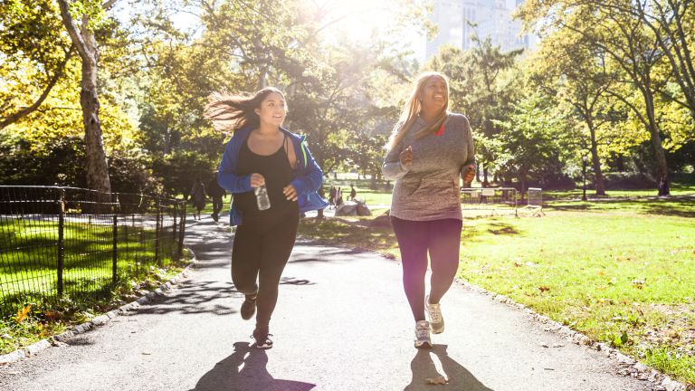 Two women running in activewear at Central Park, New York