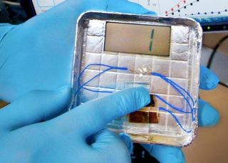 The virus-based generator works by tapping a finger on a postage stamp-sized electrode coated with specially engineered viruses. The viruses convert the force of the tap into an electric charge.