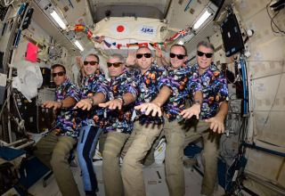 "Crewmembers on the International Space Station celebrate ""Aloha Friday."" From left to right: Joe Acaba, Alexander Misurkin, Mark Vande Hei, Cmdr. Randy Bresnik, Sergey Ryazanskiy and Paolo Nespoli."