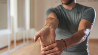 Man doing a forearm stretch.