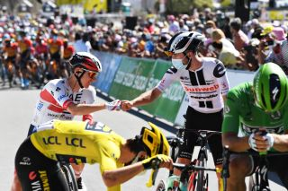 Stage 9 protagonists Marc Hirschi (Sunweb, right) – who spent most of the day solo in a breakaway – and eventual stage winner Tadej Pogacar (UAE Team Emirates, left) greet each other ahead of stage 10 of the 2020 Tour de France