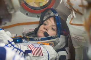 Anne McClain of NASA runs through procedures in the Soyuz MS-11 spacecraft during a vehicle fit check Nov. 20.